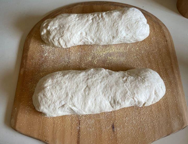 two bread loaves on peel