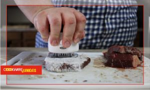 Stabbing a steak with oxo blade