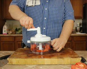 testing-tomato-chopping-with-Ultra-Chef-Express-Food-Chopper-using-manual-food-processor