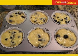 Blueberry muffins batter in the cups
