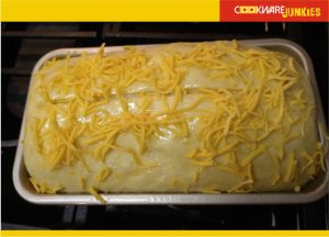 Sourdough cheese bread in loaf pan ready to bake