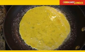 Pic American omelet raw eggsPic American omelet raw eggs in black pan