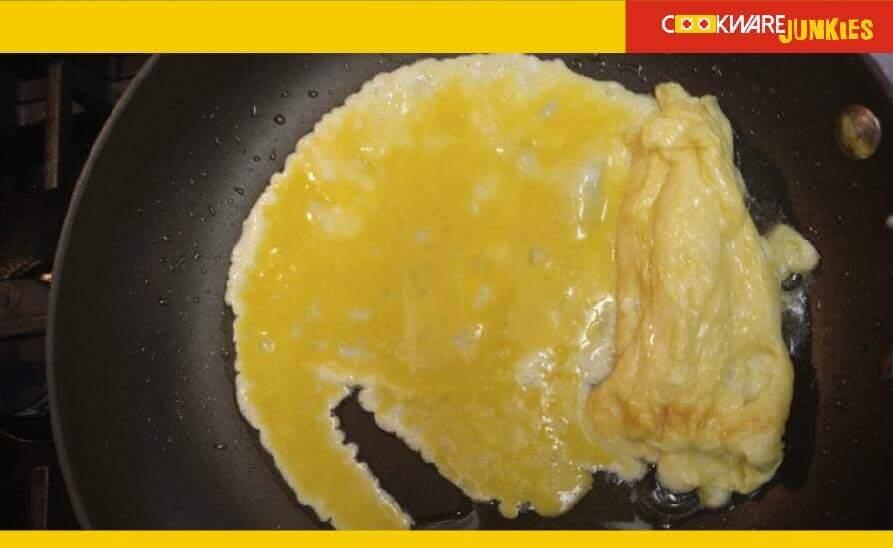 Tamagoyaki second layer in skillet in pan