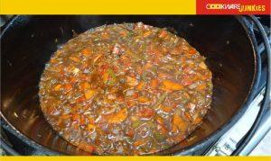 shanks cooking mirepoix in black pan
