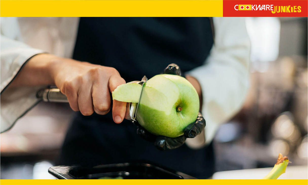 A man peeling pears with patato peeler