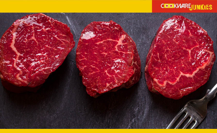 3 Filet steaks on dark gray surface
