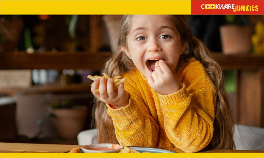 A little girl eating Fries