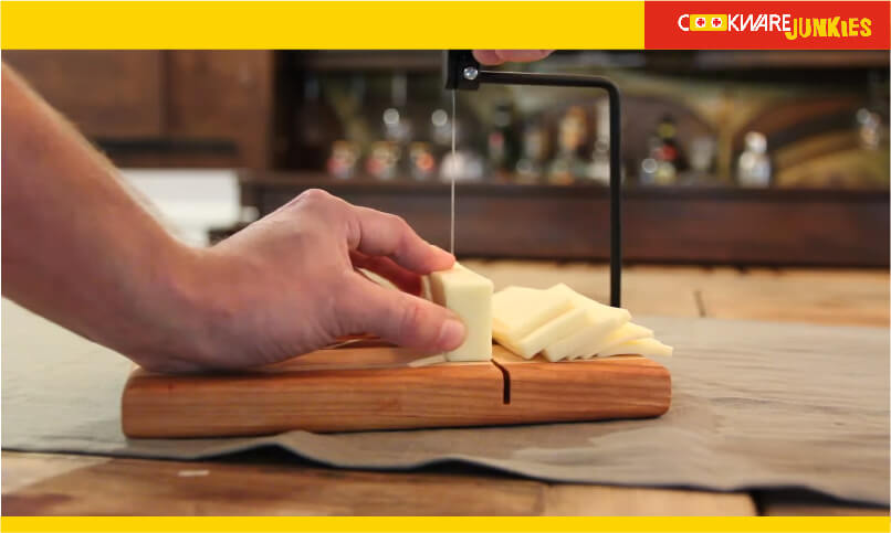 A man cutting cheese with cheese cutting Gadget