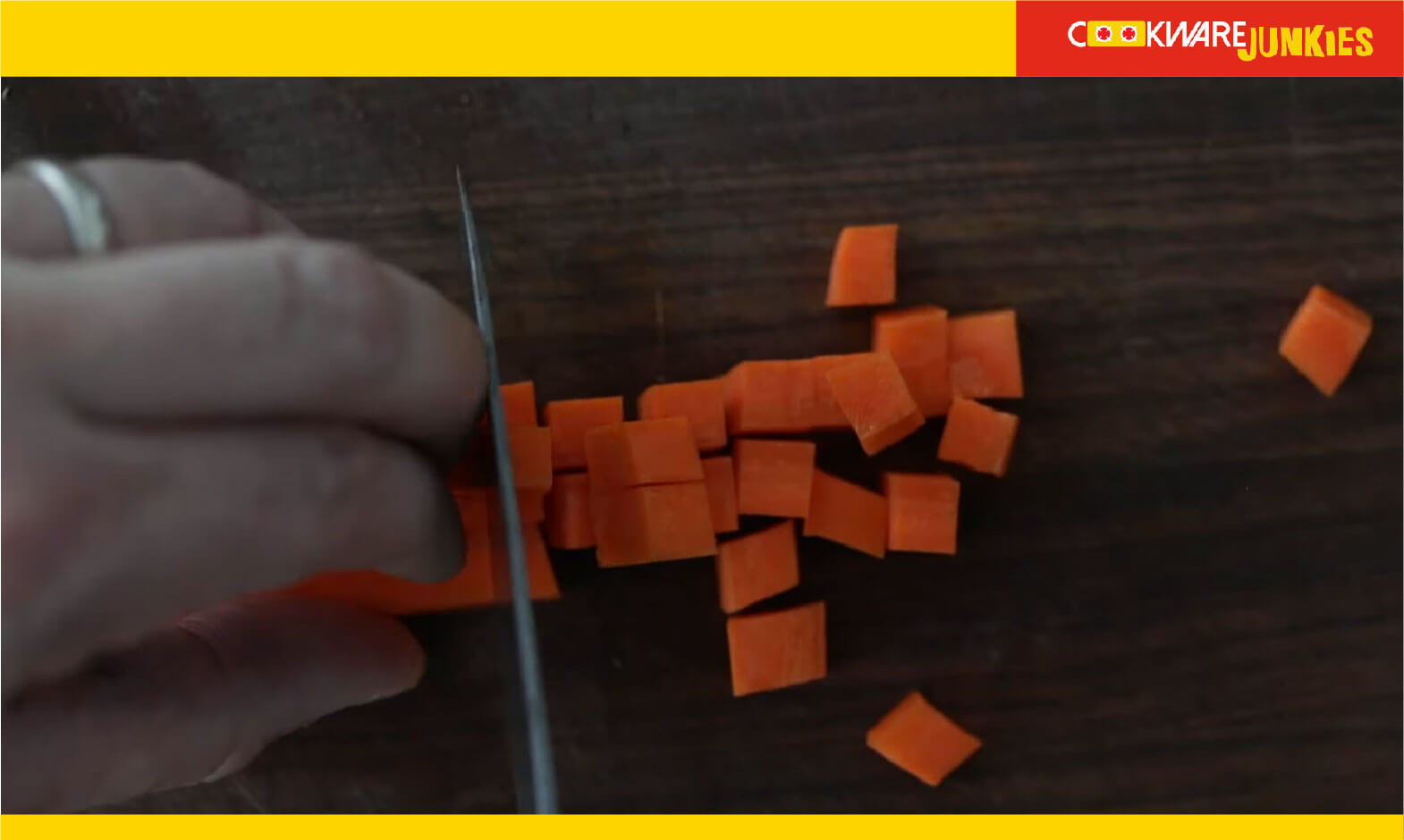Making diced cubes of carrot on wood surface