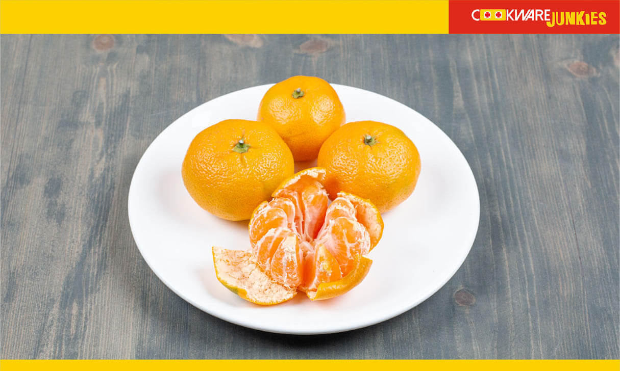 four oranges in white plate
