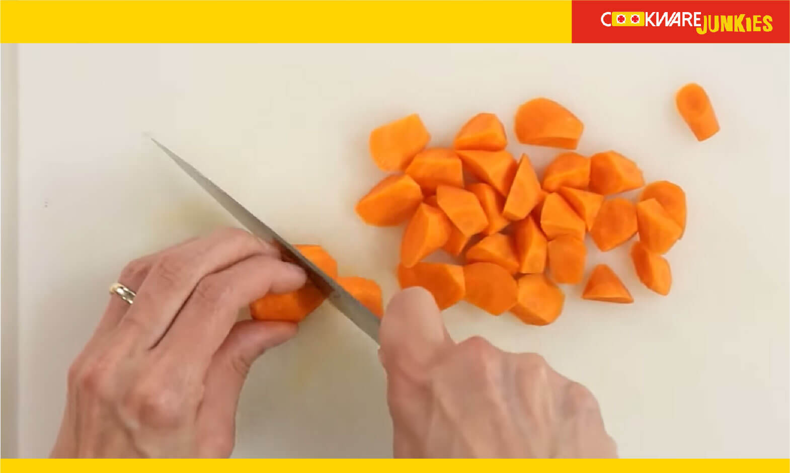 Making Roll cuts of carrot on white surface