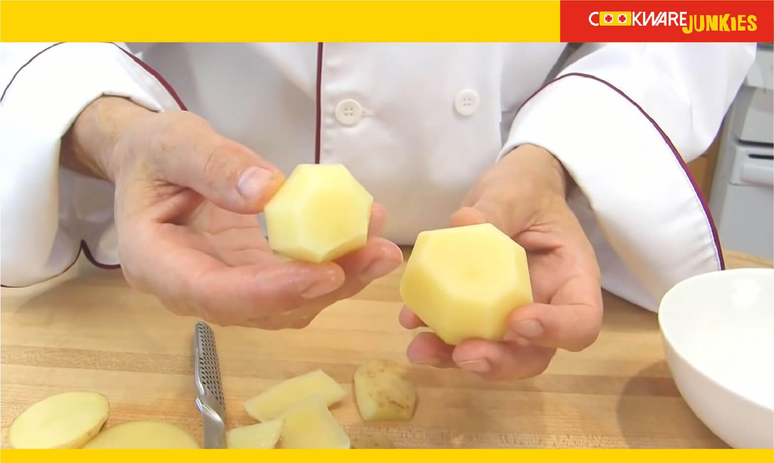 The Tourner cut potato in man hands