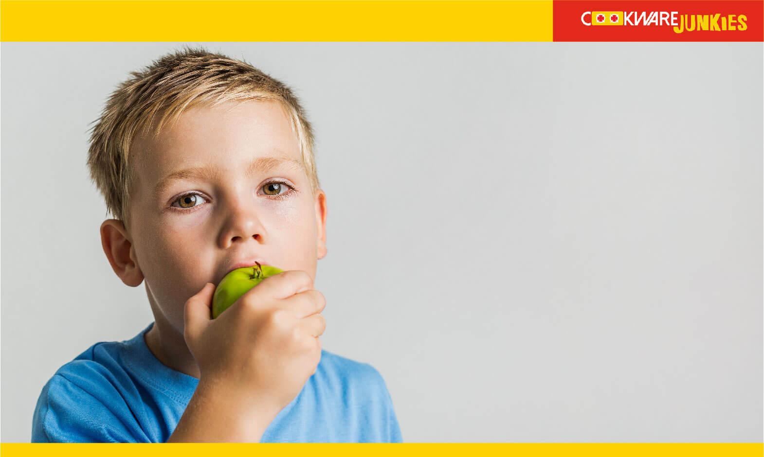 A kid eating Apple