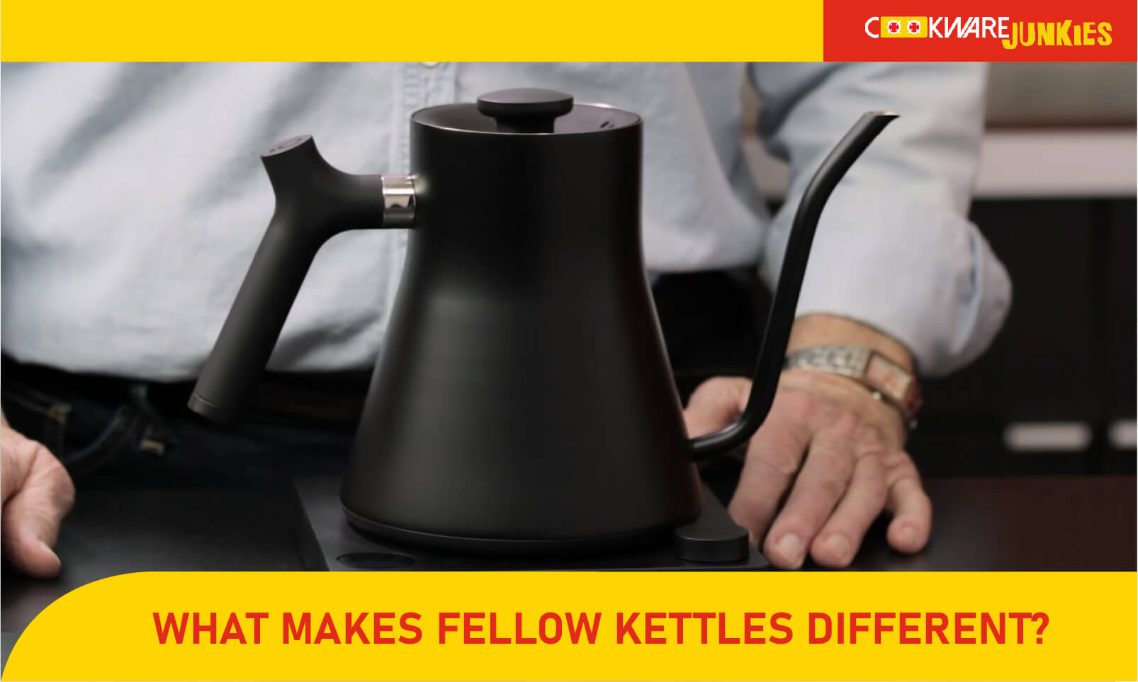 Fellow kettle on wood surface Featured image