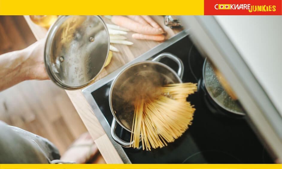 man Making pasta in kitchen image
