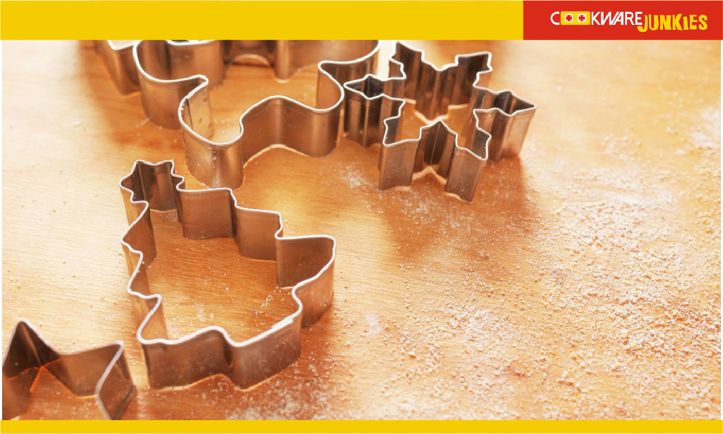Cookie cutters on wood surface