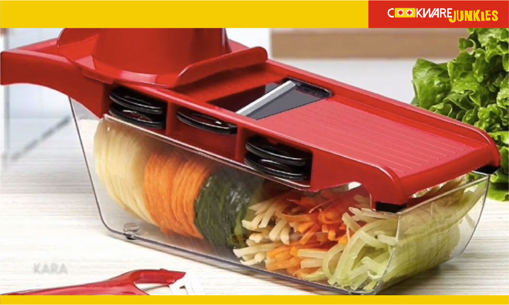 Multi-function vegetable slicer and grater on wood table