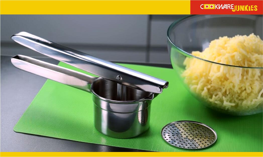 Potato press with glass bowl full patato