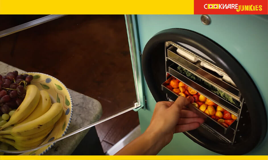 A girl placing Food in freeze-dryer