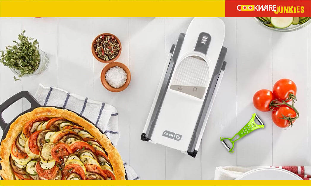 cutting tools on white surface with tamtao and vegetable pizza