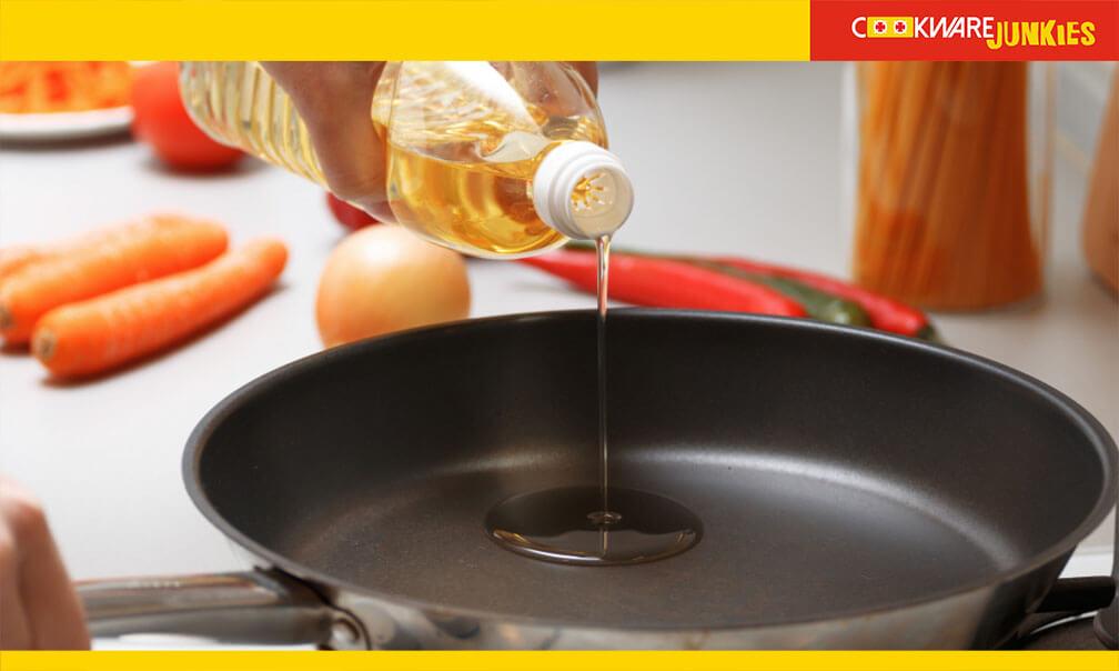 woman adding oil in pan